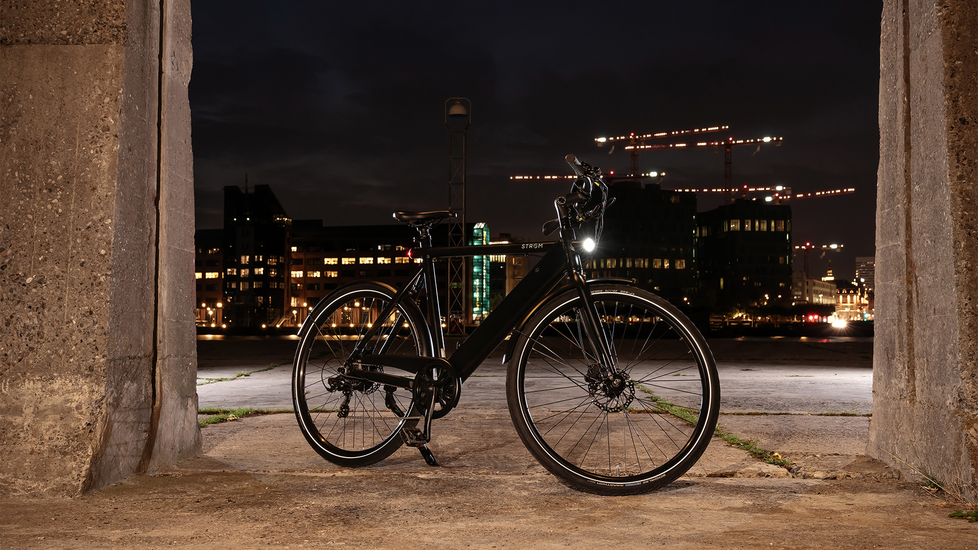 City M Ebike at night front page image